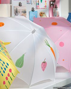 Painting Umbrellas   To make a painted umbrella, cover a work surface with newspaper, open up a umbrella, and start painting. Be sure, however, that the paint is acrylic as other paints don't have the same waterproof qualities. Keep the umbrella stay open overnight to allow the paint to dry.  What lovely way to personalize a gift!  And affordable!  KB