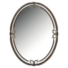 Oval mirror in a wrought iron frame.  Product: Wall mirror  Construction Material: Wrought iron and mirrored glas...
