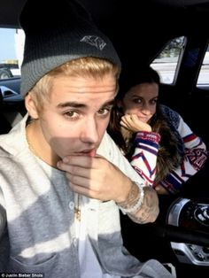 Mama's boy: Justin posted this photo with his mom on Friday, showing off his new blond loo...