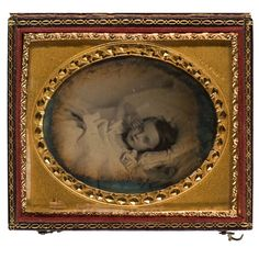with mat stamped  H.F. Warren.  A charming, yet haunting pose of a young girl on her death bed, her right hand posed touching her cheek.  Housed in a full leather case, with pleasing solar ring....