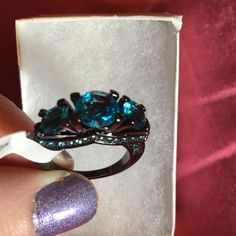 One hour sale!.  NWT. Sparkling blue CZ ring Rhodium plated. Size 7. Black base and blue CZ. Stones on front and side make this ring sparkle from all angles! Jewelry Rings