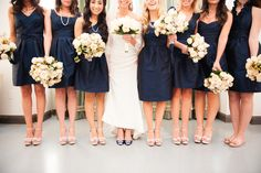 navy bridesmaids with pearls and nude/blush shoes - bride in navy pumps