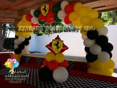 Ferrari Balloon arch and centerpieces. Checker table runners - Extreme Decorations Miami - Ph: 786-663-8198 www.extremedecorations.com