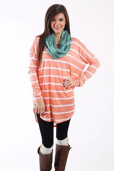 "Nice Stripes Tunic, Peach $36.50 You DO NOT want to miss this tunic! This super soft top is peach with white horizontal stripes, and we love the long length and dolman sleeves! Throw it on over leggings or skinny jeans for an outfit that's unbeatably comfy and cute, too!   Fits true to size. Miranda is wearing a small.   From shoulder to hem:  Small - 30.5""  Medium - 32""  Large - 33.5"""