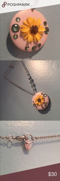 Daisy Necklace So the necklace is pale blue in the backing, I'm not sure why it's showing up pink, but there you have it. No damage. All profits go towards getting and training a service dog for myself for anxiety and PTSD. Tarina Tarantino Jewelry Necklaces