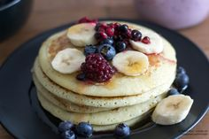 American Pancakes with berries on top and some maple syrup