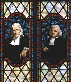 Stained glass windows depicting John and Charles Wesley.