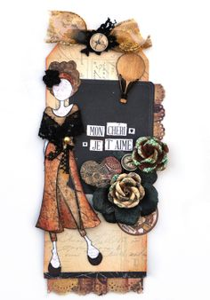 This is Julie Nutting and Prima's new Taylor doll stamp. Created with the Prima Cartographer scrapbook collection.