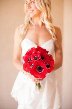 Red anemone bridal bouquet | Dennis Kwan Weddings | Brides.com