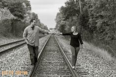 Leah and Gerry's engagement session in Fort Wayne! These two were so much fun to work with - Dustin and Corynn, Engagement and Wedding Photographers - Love on the railroad tracks