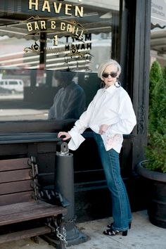 Lyn from Accidental Icon wears a classic white button down with jeans.