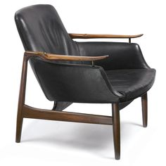 FINN JUHL ARMCHAIR, MODEL NV 53  with firm's brand rosewood and original leather upholstery 29 in. (73.7 cm) high ca. 1953 produced by Niels Vodder, Copenhagen