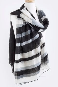 """Absolutely beautiful black, gray and white stripe scarf. Dress up the most basic outfit year round. 100% polyester. 70"""" long, 41"""" wide. A beautiful and luxurious scarf."""