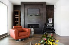 Cantoni design consultant Mercedes Williams brings life to an innovative contemporary on the 2016 Modern Atlanta Architecture Tour. Here, he punched up the cool gray fireplace with our bold orange swivel chair and architectural Caption chair in black.