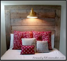 country style, barn boards used for a head board and barn light, reds, whites, and browns