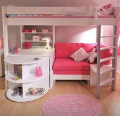Loft bed with desk, shelves, and seating area.