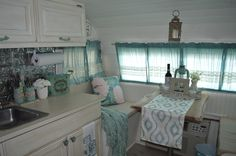 The dining area converts to a twin bed, perfect for the kids. 1967 Serro Scotty vintage camper restoration.