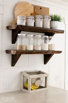 Bright Kitchen Makeover - Grouped wooden cutting boards and spice jars give a cohesive feel.