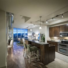 This open floor plan makes the most of a small space, and you really can't beat that view. Location: Denver, CO. Acoma Apartments.