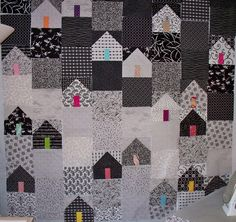 I have been looking for house block inspriration for my next quilt when I stumbled across Eschhouse's Third Street quilt. While I was intending on a more modern house type- I have been planning a black and white quilt with a single colour added to each house block. I love the vertical gradient across this quilt