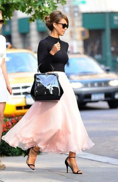Simple black sweater and pretty, flowy pink skirt. Classy
