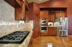 Kitchen:  Now youre cookin with gas! Easy to use propane cooktop laid in gorgeous granite. Stainless appliance package.
