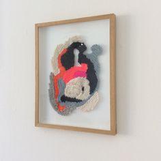 Framed knitwork by Stine Leth