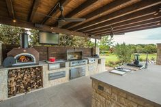 Outdoor garden kitchen designs patio kitchen ideas cook outside this summer inspiring outdoor kitchens kitchens outdoor kitchen design backyard kitchen Outdoor Kitchen Countertops, Backyard Kitchen, Summer Kitchen, Backyard Patio, Kitchen Canopy, Outdoor Kitchen Grill, Backyard Barbeque, Corian Countertops, Rustic Backyard