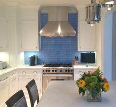 White kitchen cabinets blue tile backsplash