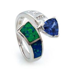 One gorgeous trillion cut tanzanite on a .925 silver ring. Stylish shape complemented with hints of australian blue opal and brilliant simulated diamonds. A true color beauty! Australian Opal Tanzanite...