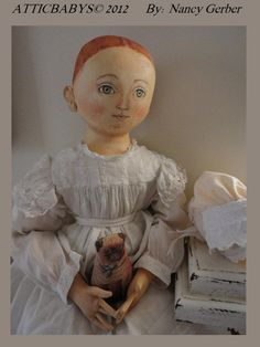 Doll with litho pug on Ebay.