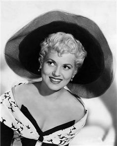 "Photos: Leading Ladies of the 1950s | Legacy.com Judy Holliday (1921 - 1965) Holliday started the decade off right, winning an Oscar for her performance in 1950's ""Born Yesterday."" Though she often played one on film, the star of ""The Marrying Kind"" and ""It Should Happen to You"" was no dumb blonde – she possessed an IQ of 172. (Getty Images / Silver Screen Collection)"