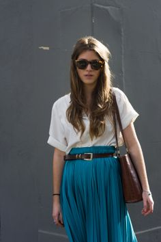 FOUREYES: Blue pleated skirt.