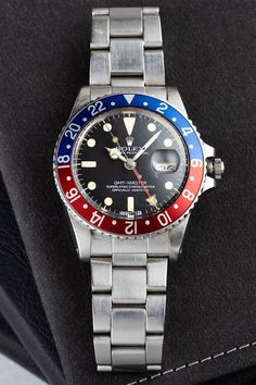 The second generation GMT-Master with the reference number 1675 was built from 1959 to 1980 and replaced the previous GMT-Master (Ref. 6542). As Rolex's pilot's watch par excellence, the Ref. 1675 introduced a wide range of innovations over its production period and is today in all its different versions one of the most popular vintage watches around. Most popular: the Pepsi bezel! Buy Rolex, Geneva Switzerland, Rolex Models, Luxury Watch Brands, Rolex Gmt Master, Black Bracelets, Vintage Watches, Rolex Watches, Two By Two