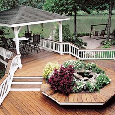 Two existing backyard features--a gazebo and a koi pond--are unifed with a pressure-treated Southern yellow pine deck that gently eases guests around the planter and up to the gazebo with a minimum of steps.    | Photo: Courtesy of Atlanta Decking and Fence Company | thisoldhouse.com