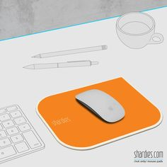 An orange 'shardies' mouse pad  adds an excitement to your work desk.