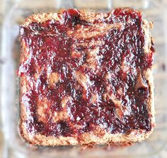 Peanut Butter and Jelly Blondies that are actually good for you. These blondies are a HUGE hit at parties... and no one ever guesses the secret!
