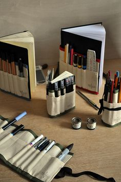 Pencil rolls. Love the idea of having pockets for pens, etc. right on the sketchbook.