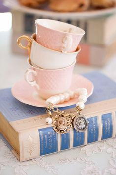 Lovely look! Vintage books and charming teacups!