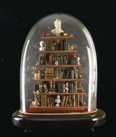 Dollhouse library beneath a glass cloche by Ettore Sobrero #glassdome #cupola #cloche - Carefully selected by GORGONIA www.gorgonia.it