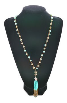 This turquoise and brown beaded necklace with tassel is adorbs!