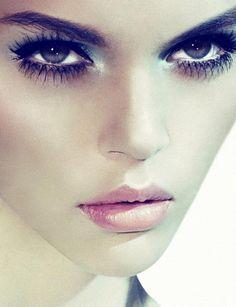 Intense eye, pink lips.