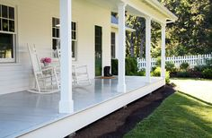 Dreamy back porch to sit and have a glass of iced tea....  A Country Farmhouse