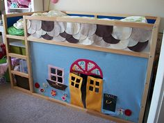 Ikea Hack felt playhouse for my son's bed. I think the Batcave would be appropriate to make.