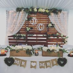 Rustic head table and backdrop. Wooden backdrop wedding