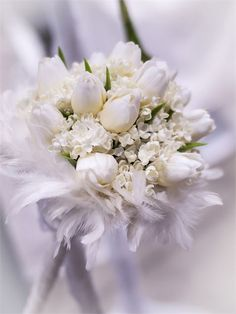 This glamorous white bouquet is created using white tulips and feathers and is perfect for a Winter wedding.