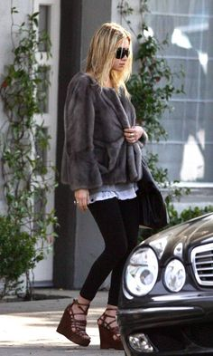 Ashley Olsen spotted in a fur coat and strappy wedges. #style #fashion #olsentwins