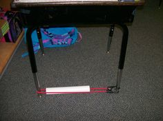 Sensory aid - slide a PVC pipe over bungi cord and attach to desk legs. Student can keep feet busy while still paying attention and staying on task.