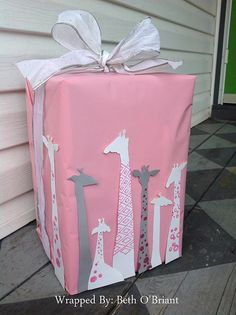 Giraffe Baby Shower Gift Wrap | by Beth O'Briant - cut silhouette from card stock and zentangle some of their necks.  This will work well on large packages.