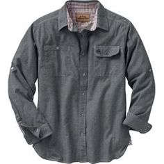 A throw-back to simpler times. Classic, rugged and simple this 100% cotton lightweight Chambray work shirt has timeless appeal with button-down pencil pocket and roll up sleeve tabs. Features bar tack construction, contrasting Gingham check collar and cuff accents, and embroidered Signature Buck decoration.